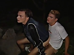 Both guys take turns on their knees servicing the other getting them both nice and hard circumcised penis of youn