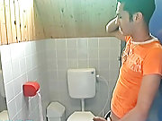 This duo, set in a toilet, features dark haired...